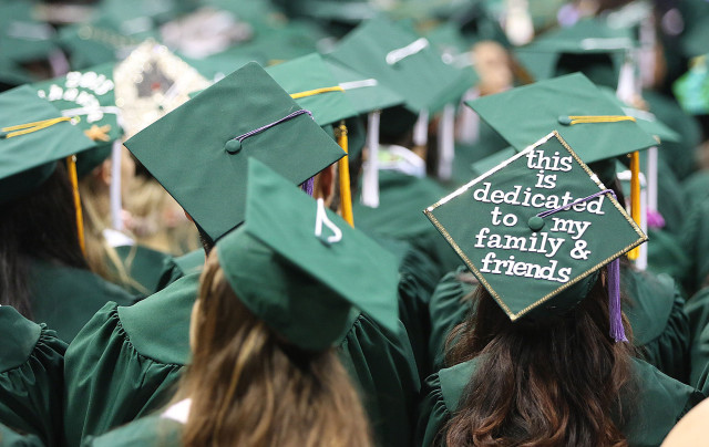 'This is dedicated to to family and friends' on a undergrad hat during commencement ceremony. 16 april 2015. photograph by Cory Lum/Civil Beat