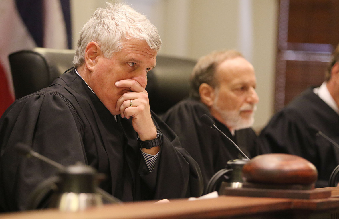 Hawaii Supreme Court Chief Justice Mark Recktenwald listens to attorneys during Hawaii State Supreme Court case involving Civil Beat's request to the HPD for records relating to disciplinary suspensions between 2003 and 2012. HPD is seeking an order requiring HPD to disclose the disciplanary suspension records.  18 june 2015. photograph Cory Lum/Civil Beat