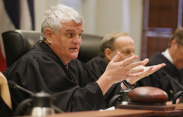 Hawaii Supreme Court Chief Justice Mark Recktenwald raises questions during Hawaii State Supreme Court case involving Civil Beat's request to the HPD for records relating to disciplinary suspensions between 2003 and 2012. HPD is seeking an order requiring HPD to disclose the disciplanary suspension records. 18 june 2015. photograph Cory Lum/Civil Beat