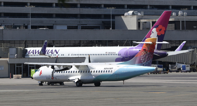 Island Air and Hawaiian airlines aircraft sit near the Honolulu Interisland Terminal. Airport. 22 june 2015. photograph Cory Lum/Civil Beat