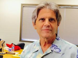 Ian Lind: Ethics Director Survives Political Challenge