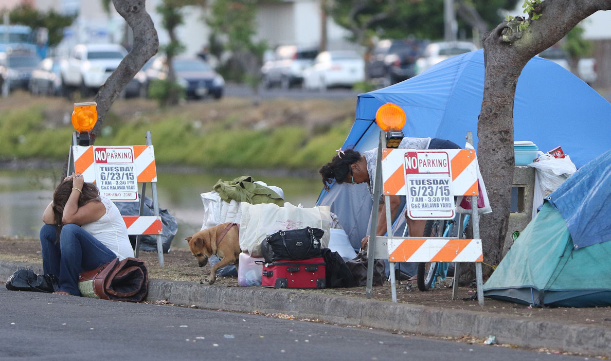 Just after 6am, residents disassemble tents and structures along Kohou Street/Kaumualii street intersection to wait out the impending 'compassionate disruption' from the City and County. I left before the big trucks showed up. Most of what was left on the banks/sides of Kapalama Canal were large piles of materials that included chairs and other medium/large builky trash. 23 jun3 2015. photograph Cory Lum/Civil Beat