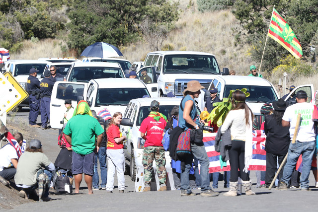DLNR vehicles are stopped at the bottom of the road leading to the summit of Mauna Kea early in the morning. The demonstrators strategized by having many layers of supporters, creating a barrier against TMT workers trying to reach the summit. 24 june 2015. photograph Cory Lum/Civil Beat