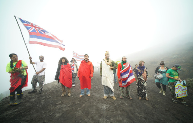 Mauna Kea supporters chant along the summit access road. 24 june 2015. photograph Cory LUm