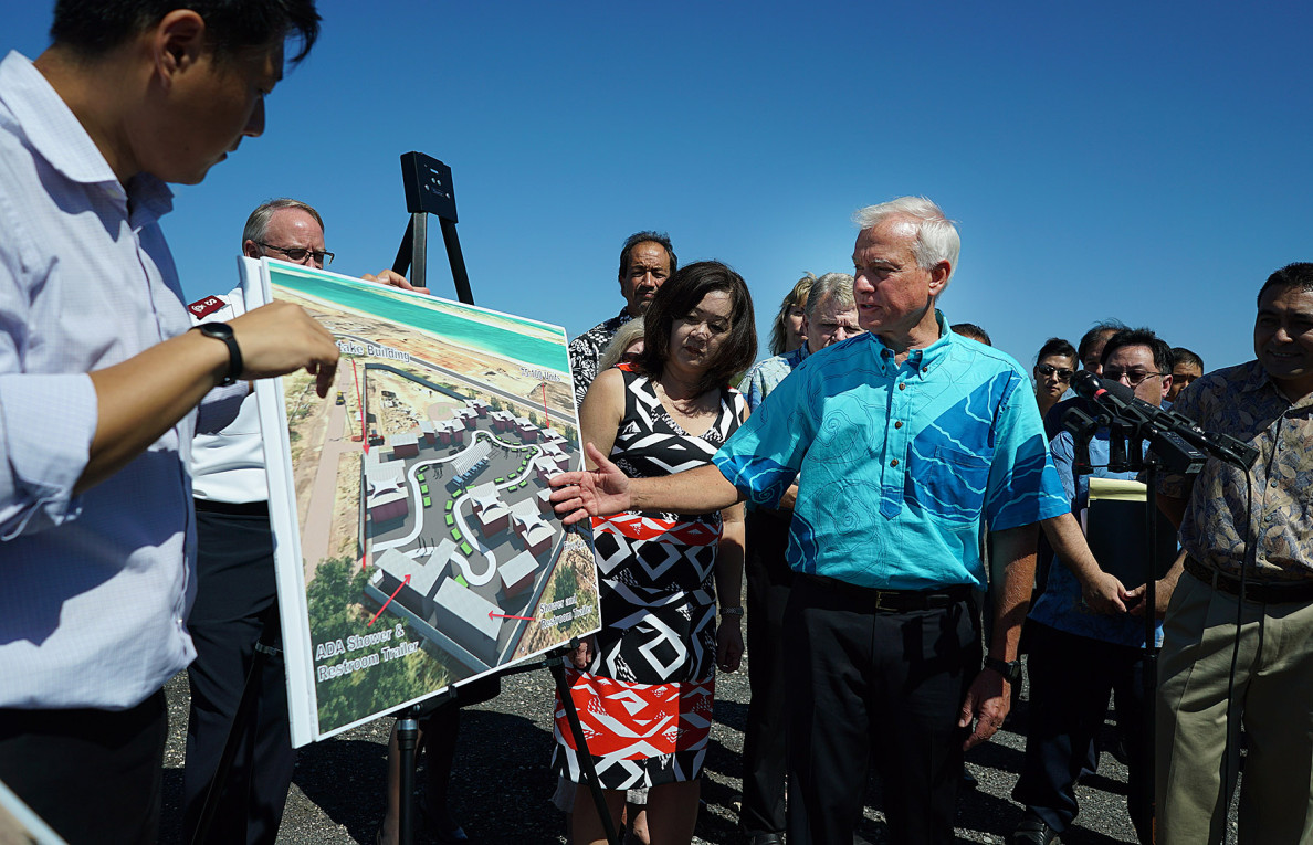 Mayor Kirk Caldwell discusses the layout of the ADA showers and restrooms in Sand Island homeless community during press conference held at Sand Island. 2 june 2015. photograph Cory Lum/Civil Beat