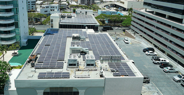 Rooftop solar panels / photovoltaic system installed on adjacent building near Ala Moana Center. 10 june 2015. photograph Cory Lum/CIvil Beat