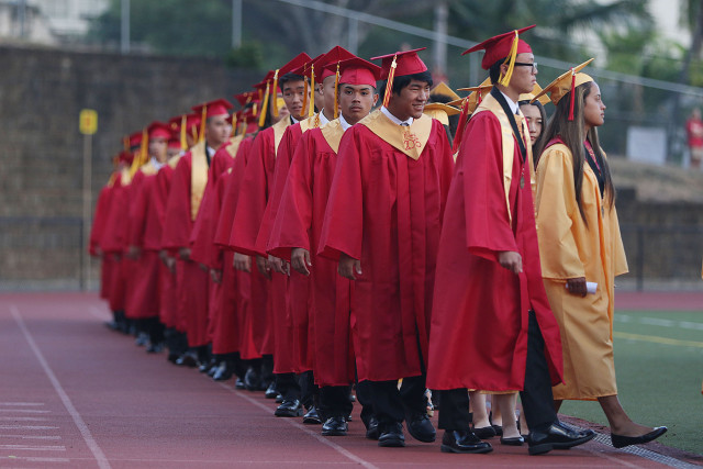 Students lineup before Roosevelt High School graduation ceremony. 30 may 2015. photograph Cory Lum/Civil Beat