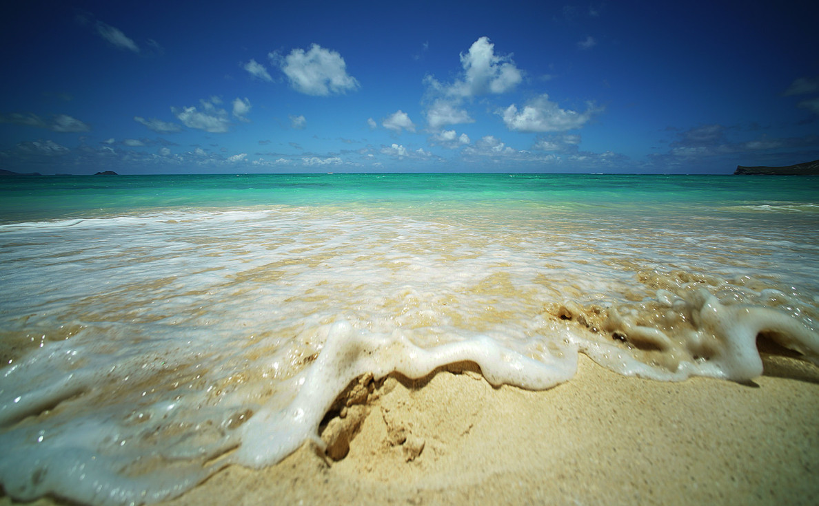 Small waves come ashore azure green and blue waters at Waiamanalo Beach. 2 june 2015. photograph Cory Lum