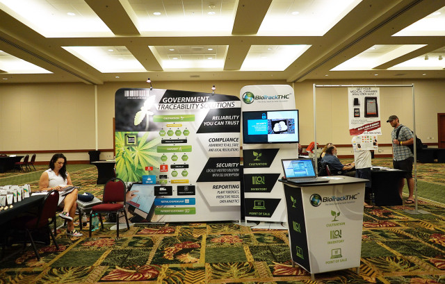BioTrackTHC booth at the Marijuana Expo held at the Hawaii Convention Center. BioTrackTHC is a software company that tracks from medical marijuana seeds to point of sale. 19 july 2015. photograph Cory Lum/Civil Beat