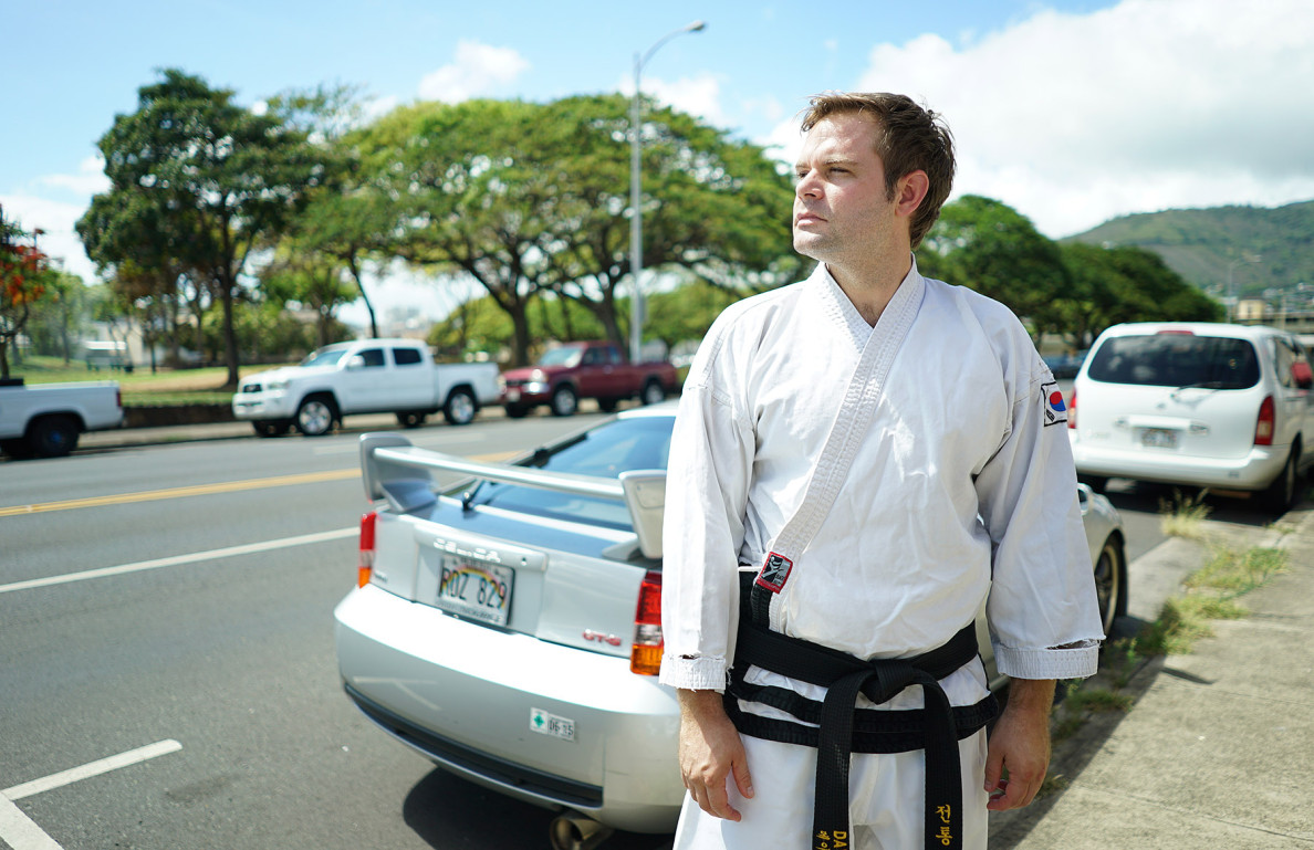 Tae Kwon Do instructor David Ippen stands fronting his school with view of Old Stadium Park on Isenberg Street. 19 july 2015. photograph Cory Lum/Civil Beat