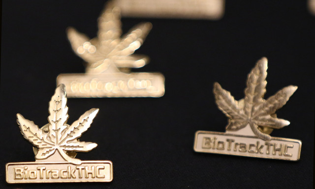 BioTrackTHC pins on display during the Marijuana Expo held at the Hawaii Convention Center. 19 july 2015.  photograph Cory Lum/Civil Beat