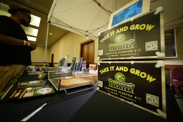 """Take it and Grow' grow kit on display at the Green Hands of Aloha booth at the Marijuana Expo. Hawaii Convention Center. 19 july 2015. photograph Cory Lum/Civil Beat."