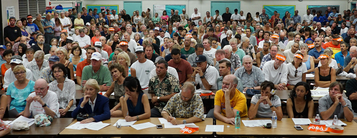 Hundreds of Hawaii Kai residents gather at Hahaione Elementary School cafeteria to listen to Malia Chow, National Oceanic and Atmospheric Administration Sanctuary Superintendent, Suzanne Case, Director of the state Departmentof Land and Natural Resources concerning the proposed plan to designate Maunalua Bay a Special Sanctuary Management Area. SSMA. 14 july 2015. photograph Cory Lum/Civil Beat