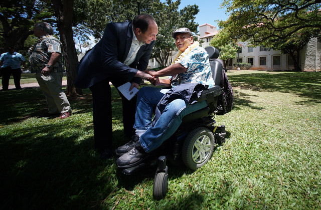 Secretary of Veteran Affairs Robert McDonald greets former homeless veteran Calvin Munies after 'Heroes Housing Heroes', Mayor Caldwell's initiative to house 100 U.S. veterans by the end of 2015. 9 july 2015. photograph Cory Lum/Civil Beat
