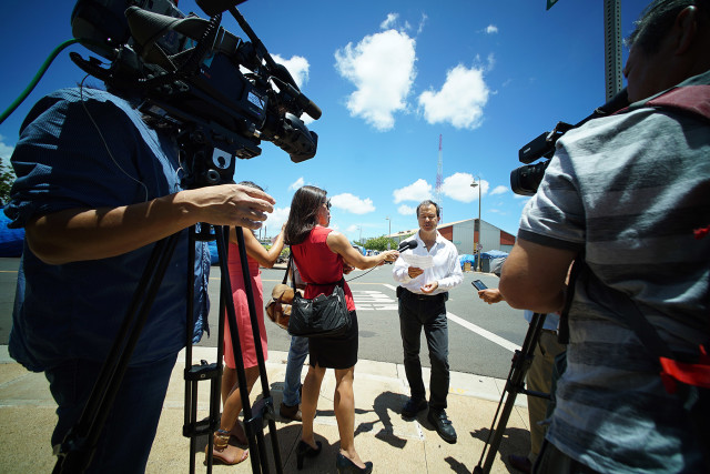 Wide view of Rep Tom Brower giving press conference announcing he will press charges. Brower called the press conference at the corner of Ohe and Olomehani Streets. 23 july 2015. photo Cory Lum/Civil Beat
