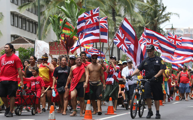 Thousands of Aloha Aina Unity marchers head toward Kapiolani Park from Saratoga Road. 9 aug 2015. photograph by Cory Lum/Civil Beat