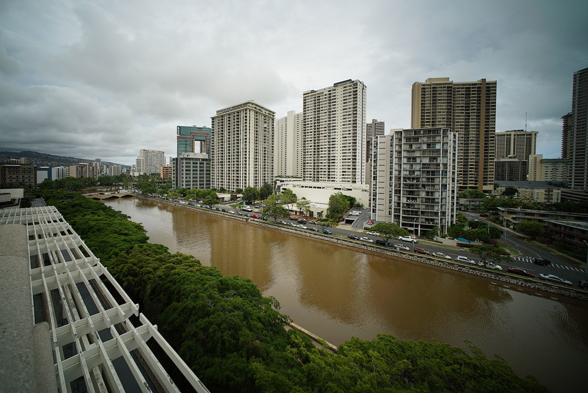 Brown water of Ala Wai Canal after torrential downpour from tropical storm 'Kilo' and sewage spill along Ala Moana Boulevard. 24 aug 2015. photograph Cory Lum/Civil Beat
