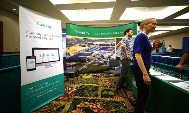 SolarCity booth at the Asia Pacific Resilience Innovation Summits and Expo held at the Hawaii Convention Center. Honolulu Hawaii. 24 aug 2015. photograph Cory Lum/Civil Beat
