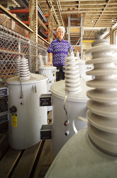 Chief Executive Officer and President Hawaiian Electric Company Alan Oshima shows some of the wares on the grounds of the company's Ward Avenue headquarters.