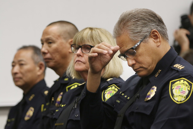 Honolulu Police Department Chief Louis Kealoha sits during anouncement of Smart 911 at HPD headquarters. 9 sept 2015. photograph Cory Lum/Civil Beat