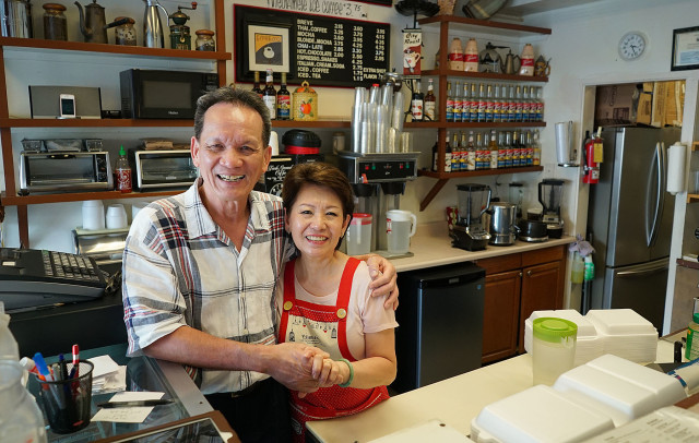 Hiep Vu with wife right, Lethu thi Hoang at their coffee shop in Kakaako called 'Insomnia'.  22 sept 2015. photograph Cory Lum/Civil Beat