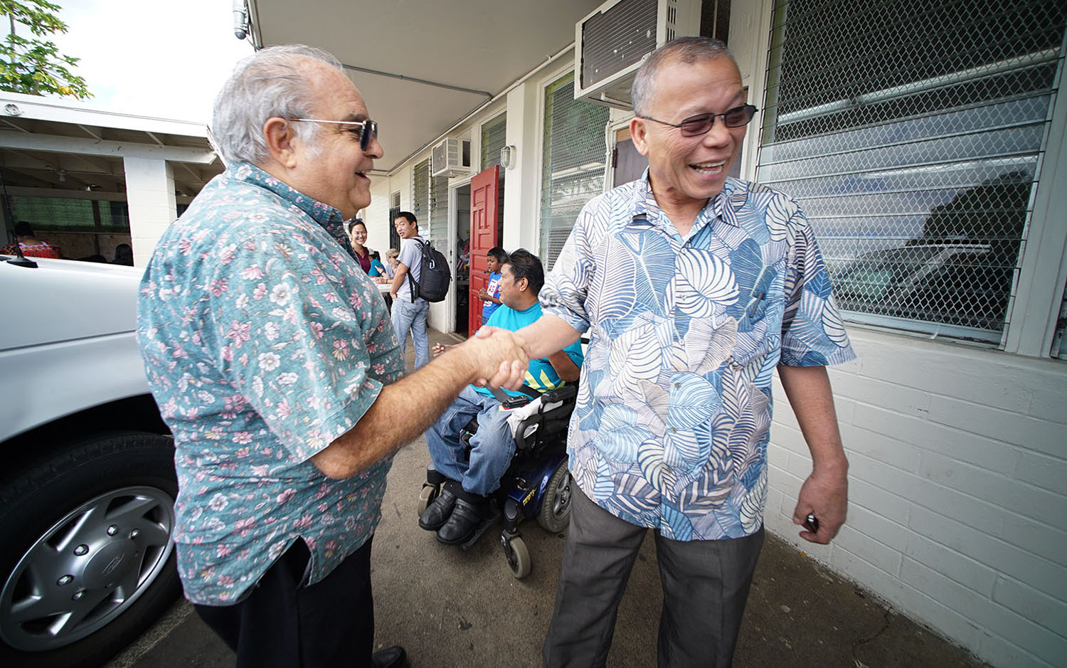 <p>Asterio Takesy, right, the ambassador to the U.S. from the Federated States of Micronesia, helped immigrants sign up for health care at the Kalihi church earlier this year.</p>