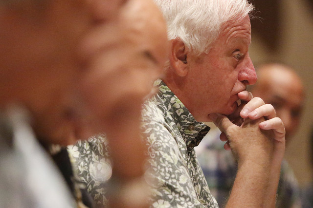 PUC Commisioner Michael Champley listens to testimony on the NextEra merger.