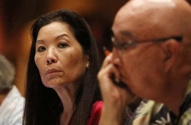 Hawaii Public Utilities Commissioner Lorraine Akiba, left, Chair Randy Iwase listen to public testimony on the proposed NextEra Energy-Hawaiian Electric Industries merger.