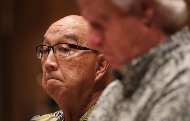 Hawaii Public Utilities Commission Chair Randy Iwase listens to public testimony at McKinley HS on the proposed NextEra Energy/Hawaiian Electric Industries merger. 27 oct 2015. photograph Cory Lum/Civil Beat
