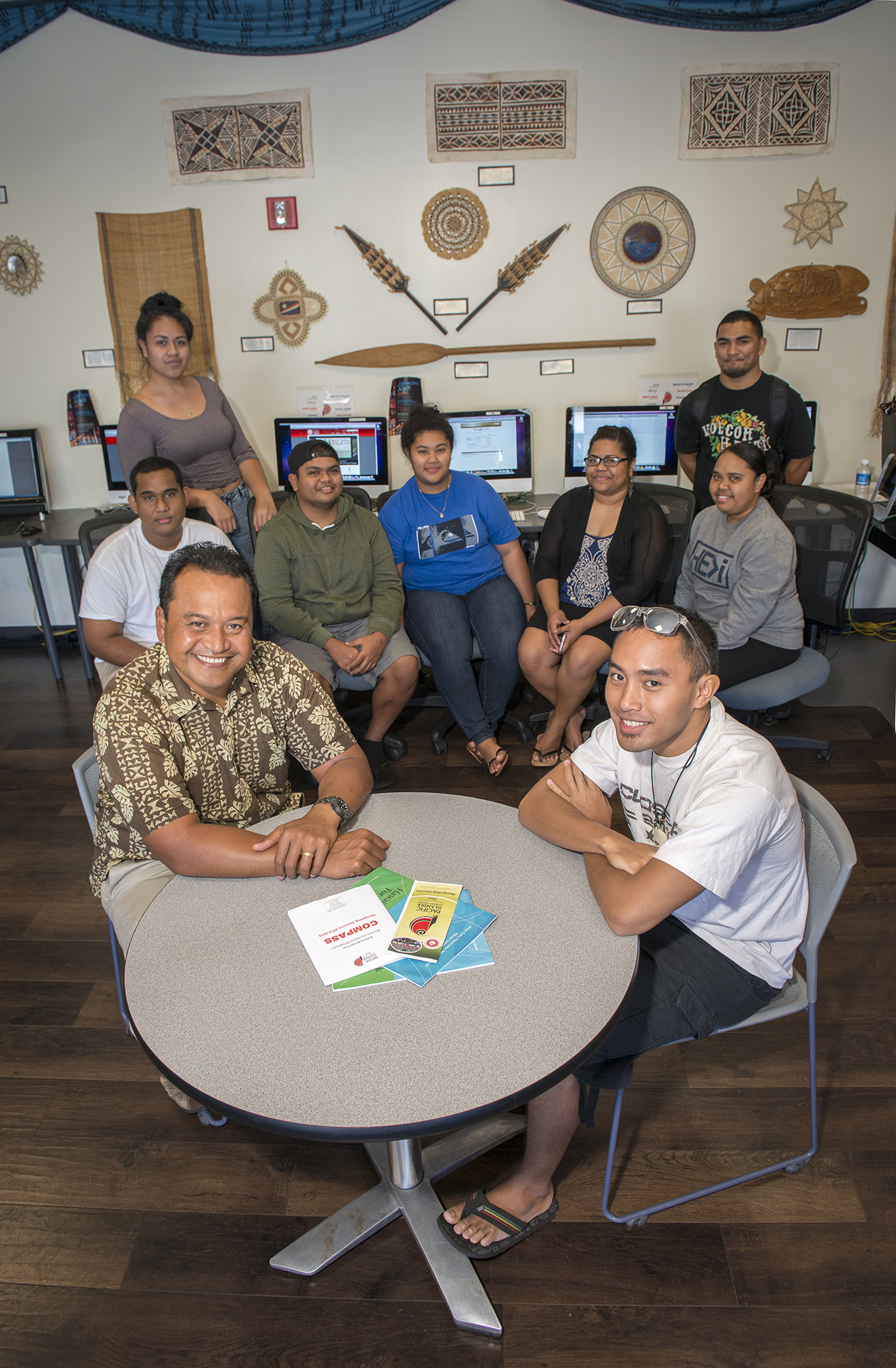 <p>Vidalino Raatior, left, with Micronesian students and staff at the Pacific Islander Student Center at UH Hilo. Raatior runs the student center and is determined to help fellow Micronesians settle successfully in Hawaii.</p>