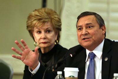 Guam Governor Eddie Calvo makes point, background Guam Congressional Delegate Madeleine Bordallo looks on during 2015 Senior Plenary Session of the Interagency Group on Insular Areas. South Interior Auditorium. Washington DC. 24 feb 2015. photograph Cory Lum/Civil Beat
