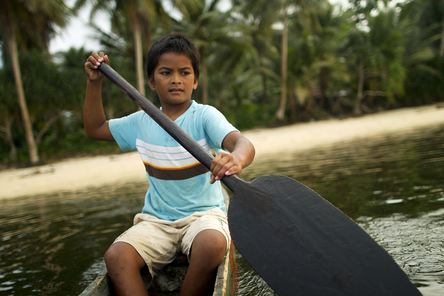 <p>A boy in Walung paddles home.</p>
