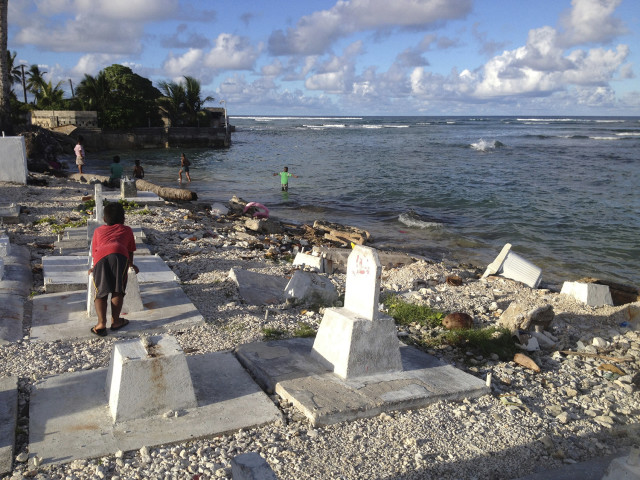 Rising tides are taking their toll on this Majuro graveyard. Tombstones and markers are slipping into the sea as the ocean claims the land.