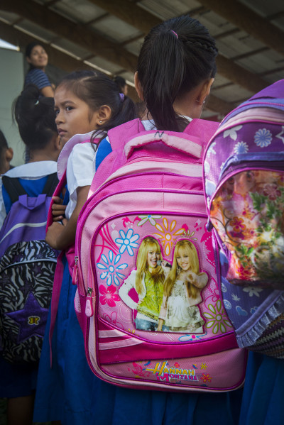 Despite an economy in trouble, families still need the basics of life, including backpacks that appeal to kids.