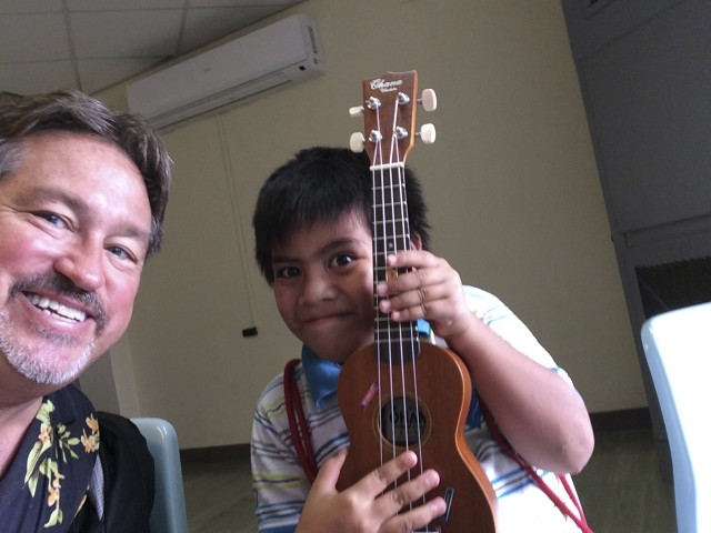 Chad Blair and a young resident of Pohnpei in the Federated States of Micronesia. November 2014