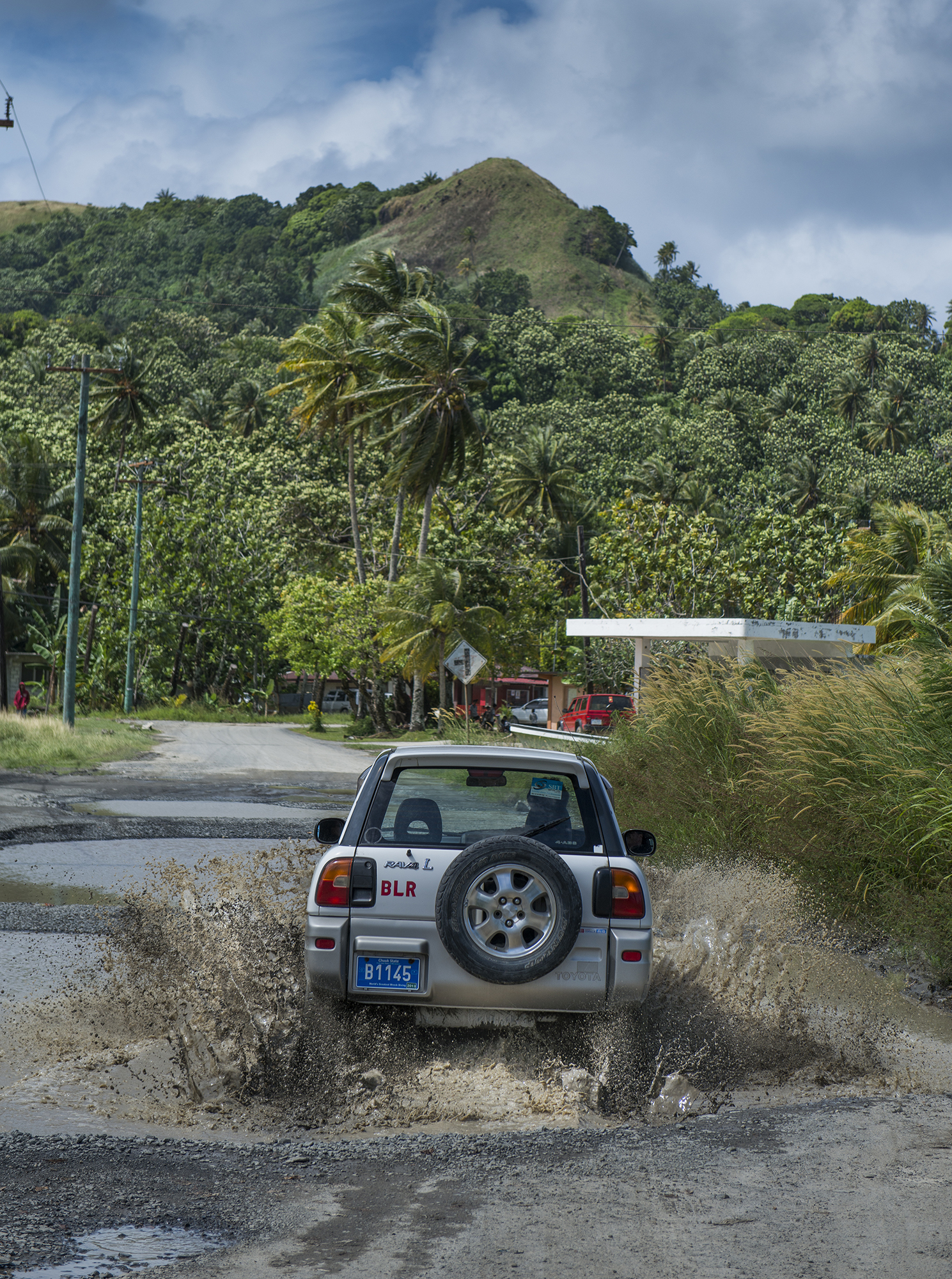 <p>The main road on Weno in Chuuk often floods, but most locals take things in stride.</p>