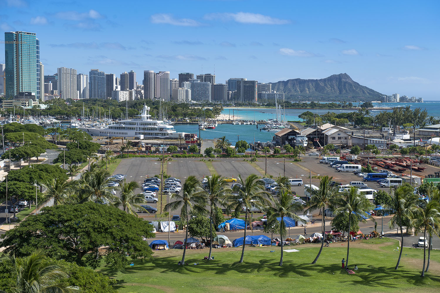 <p>Hundreds of homeless people, including many Micronesians, set up camp in the Kakaako area near downtown Honolulu. The city has worked to clear the area, but homelessness persists.</p>