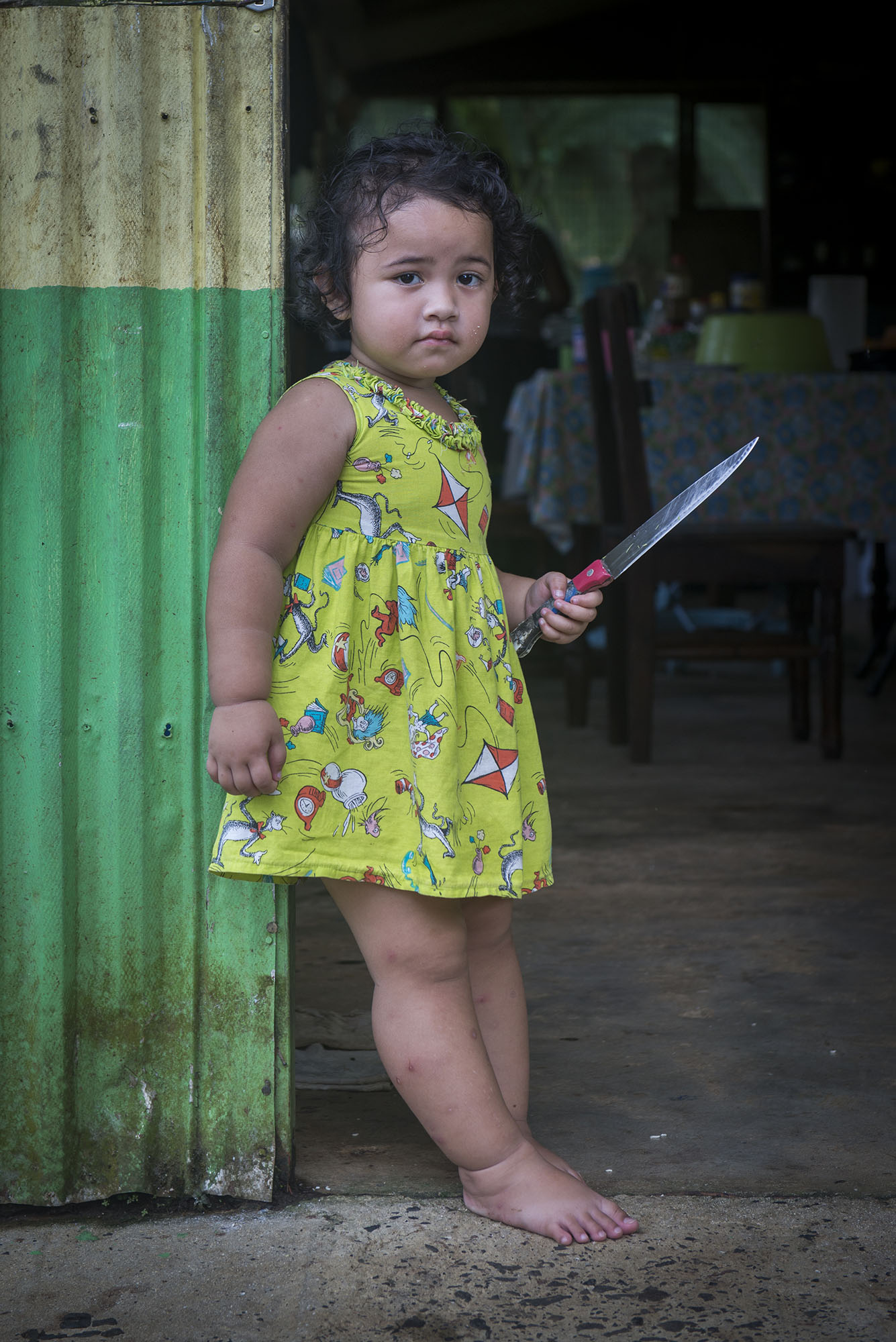 <p>A little girl watches from a doorway in the rural countryside of Pohnpei in the Federated States of Micronesia.</p>