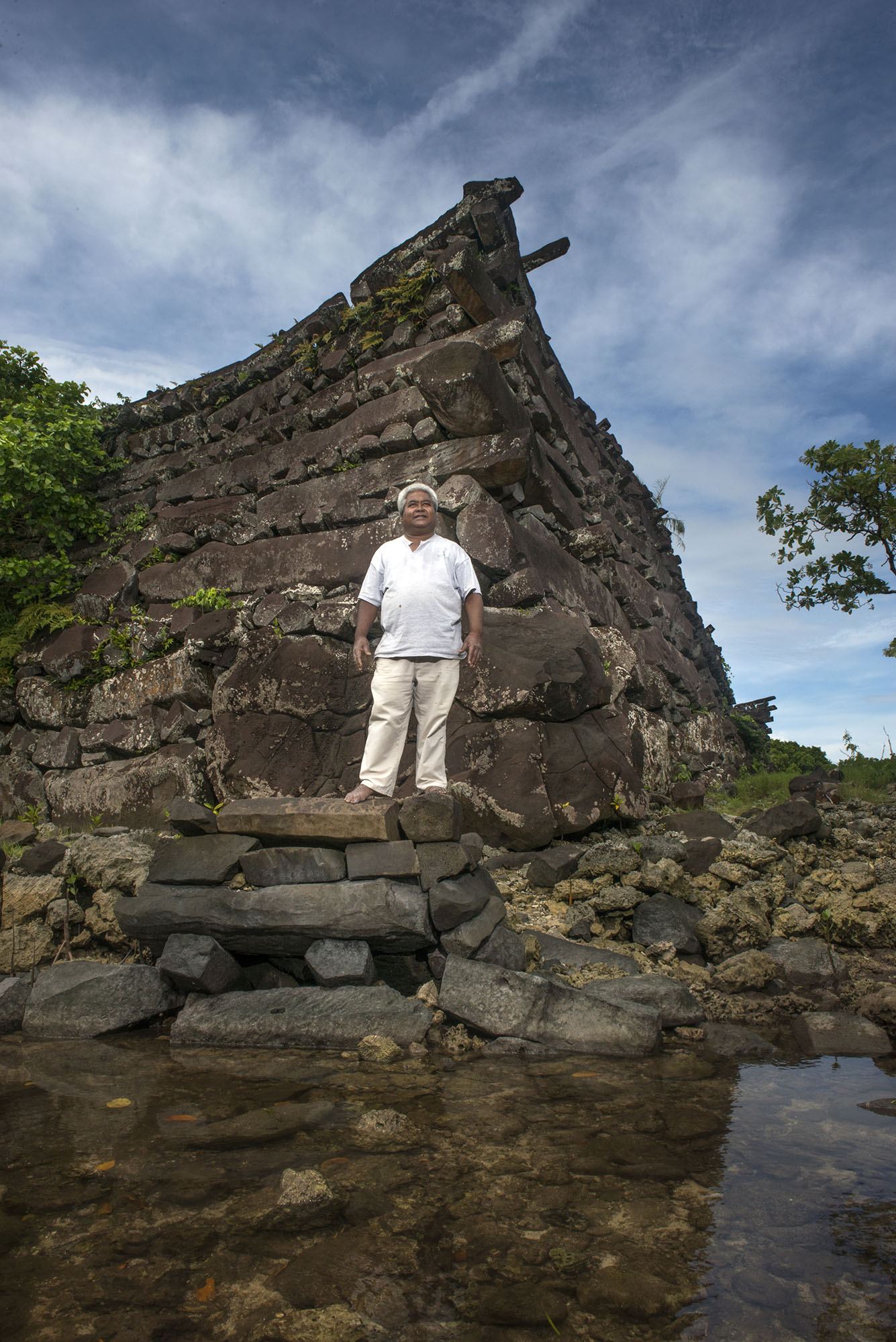 <p>Sam Saul at the the Nan Madol, located not far from his home. The ruined city is on the eastern shore of Pohnpei and was the capital of the Saudeleur Dynasty until the early 1600s.</p>