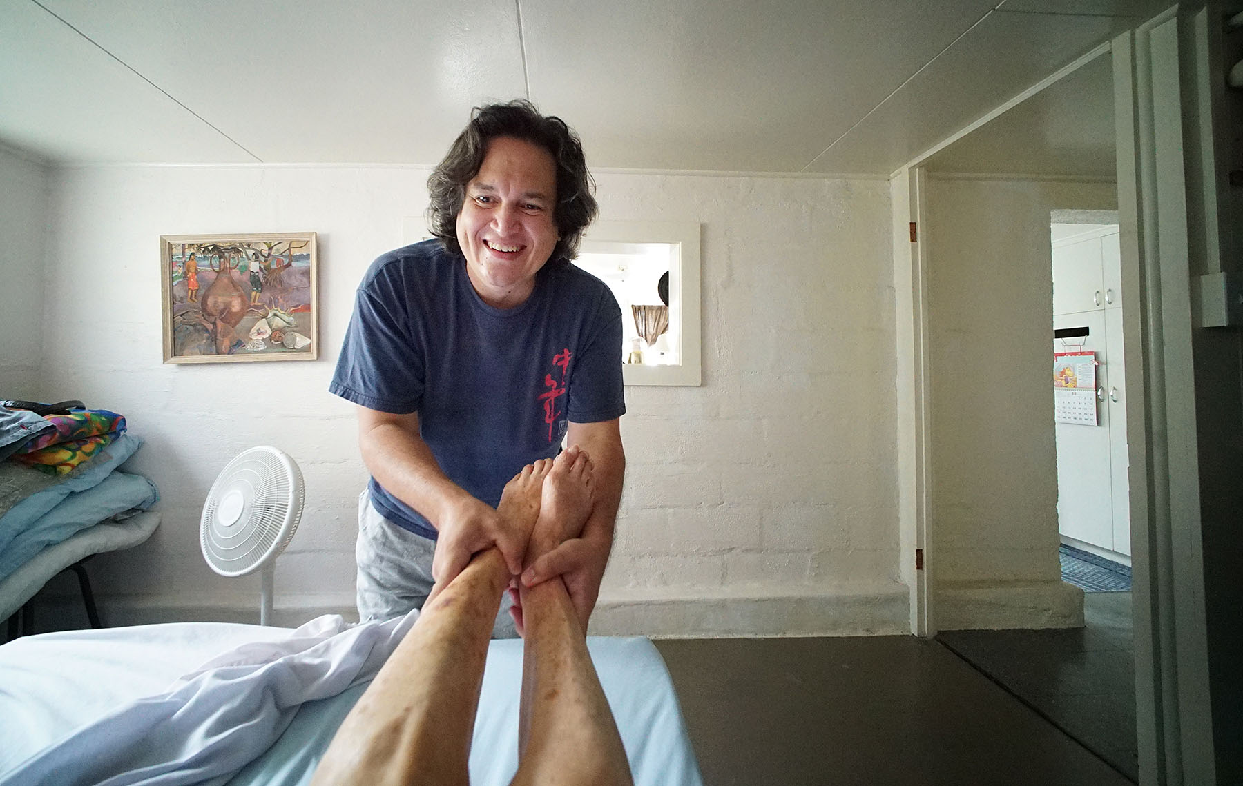 <p>Eugene is her primary caregiver and is with her several days a week. He starts her day by massaging her feet.</p>
