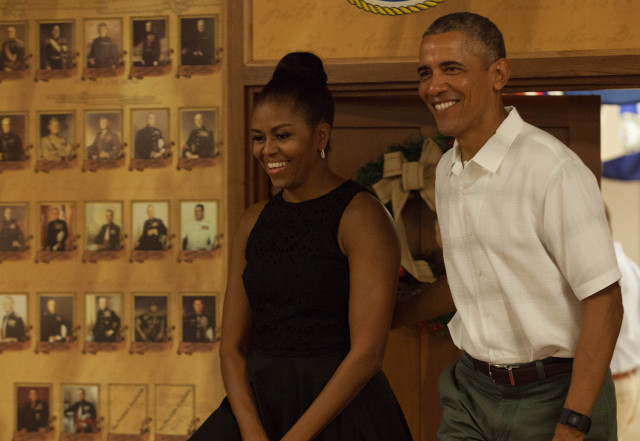 Barack Obama and Michelle Obama speak to U.S. service members on Christmas Day at Marine Corps Base in Kaneohe, Hawaii. Photo by Anthony Quintano/Civil Beat