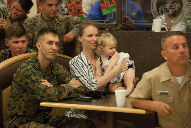 U.S. service members and their loved ones look on as President Barack Obama and Michelle Obama visit the Marine Corps Base in Kaneohe, Hawaii. Photo by Anthony Quintano/Civil Beat