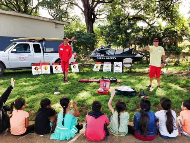 Lifeguards teach students about ocean safety at Makaha Elementary School.