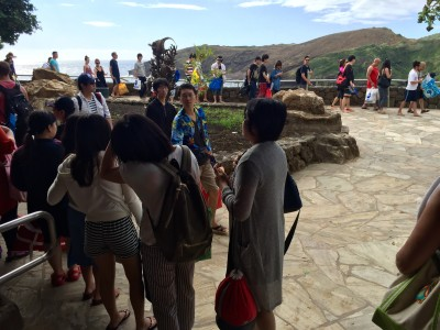 A line snakes around the entrance to the theater at Hanauma Bay where first-time visitors must watch a safety video.