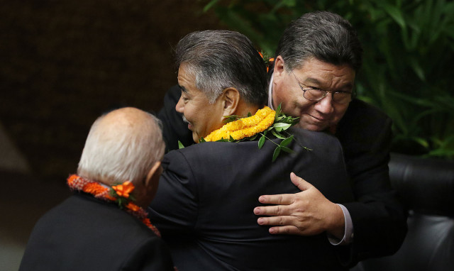Gov. David Ige is greeted by Senate President Ron Kouchi, right, and House Speaker Joe Souki, at left.
