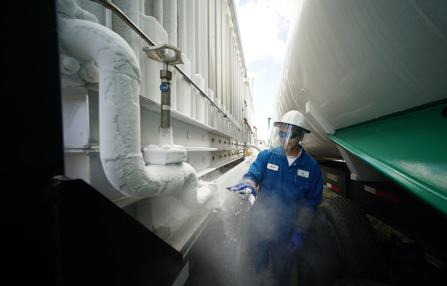 Kevin Tanaka works away at the Hawaii Gas pressure controller near Pier 38 as natural gas is delivered. Hawaii already uses natural gas, but not for electricity production.