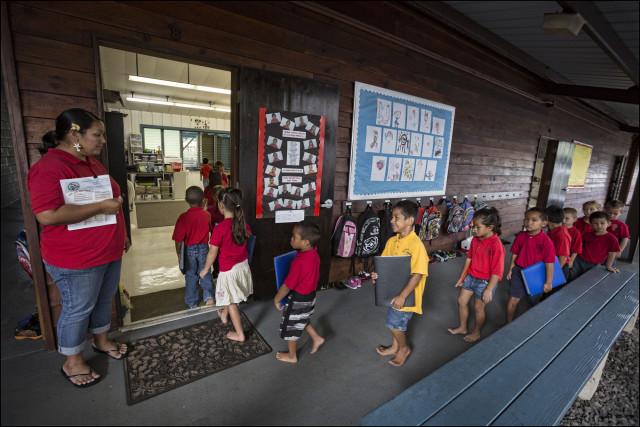 Students walk into classroom at the Nawahiokalani'opu'u Hawaiian Immersion School in Keaau, Hawaii.