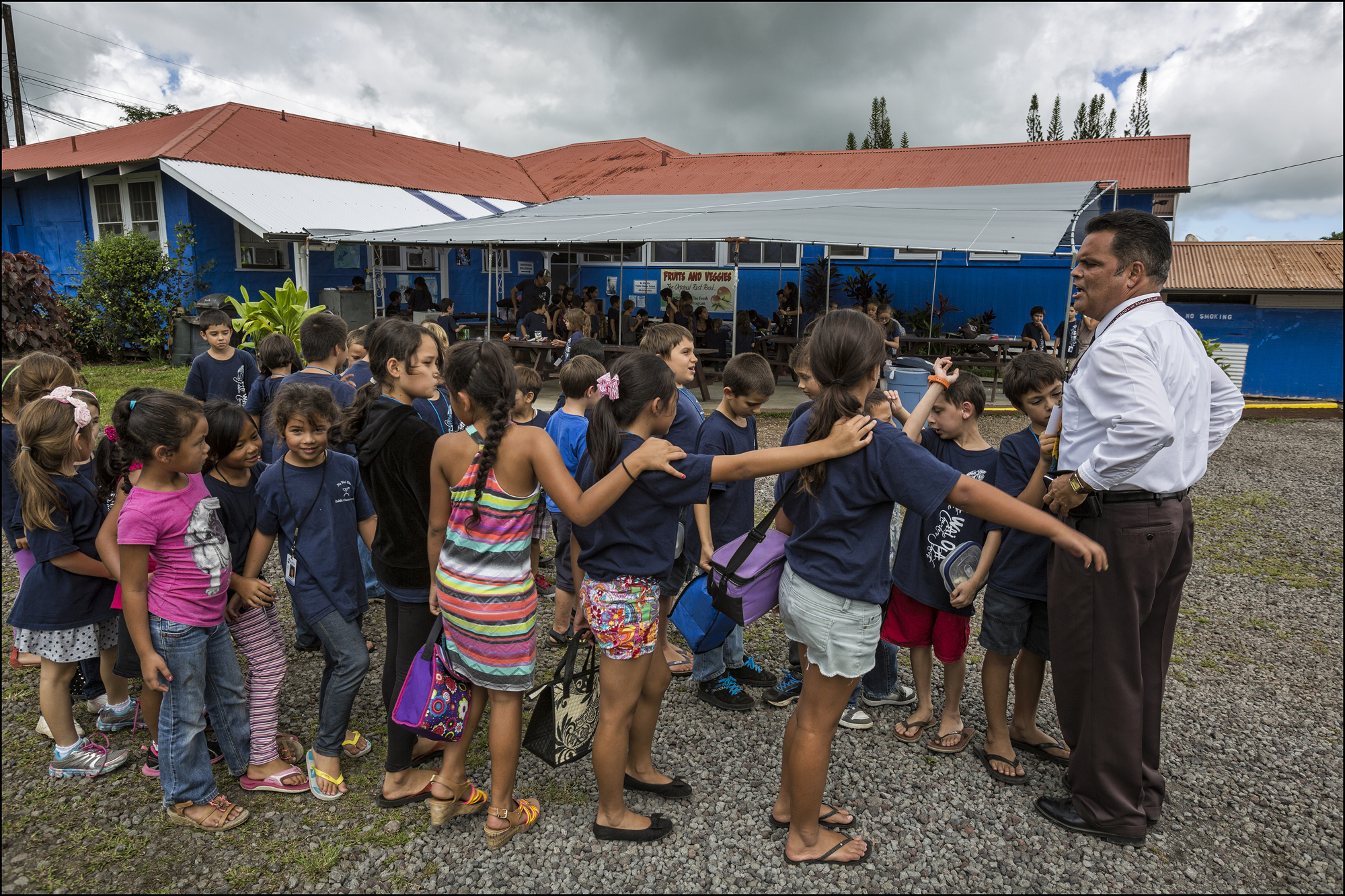 At the Na Wai Ola Public Charter School, located  in Mountain View, HI, Principal Daniel J. Caluya get students organized in two lines.