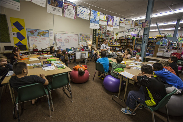 5th grade teacher Kathleen Wines works with students in class at Connections public charter school located the Kress building in downtown Hilo, HI
