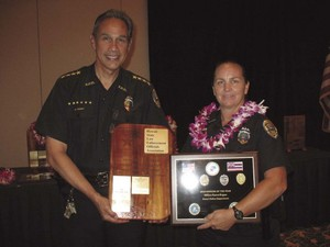 Karen Kapua, right, was arrested for allegedly stealing money from the Kauai Police Department.